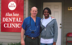 Dentist volunteering at Allen Saxe Clinic