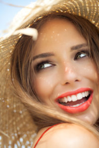 woman with a beautifully restored smile thanks to the dental crowns north dallas loves