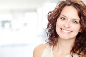 woman brunette smiling perfect teeth