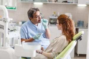 woman learns about cosmetic dentistry myths